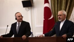 Turkish Foreign Minister Mevlut Cavusoglu (left) made his remarks after meeting his Iranian counterpart Mohammad Javad Zarif (right) in Ankara. (file photo)