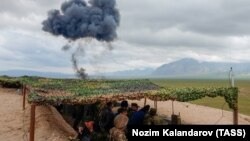 FILE: A joint Russian-Tajik military exercise near the Afghan border in March