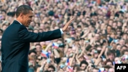 U.S. President Barack Obama waves after speaking at Prague Castle