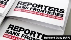 FRANCE -- Press releases are pictured during a press conference of Reporters Without Borders (RSF) to present the its World Press Freedom Index for 2018, in Paris, April 25, 2018