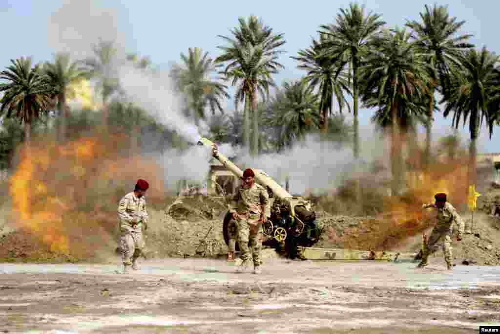 Iraqi security forces fire artillery during clashes with the Al Qaeda-linked Islamic State in Iraq and the Levant in Jurf al-Sakhar on March 17. (Reuters/Alaa al-Marjani)