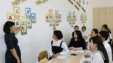 Kazakhstan - A picture taken on September 25, 2018 shows children attending a class at Astana's school number 76. The classrooms of school number 76 in Kazakhstan's capital Astana are buzzing with change as old words take on new forms and teachers struggl