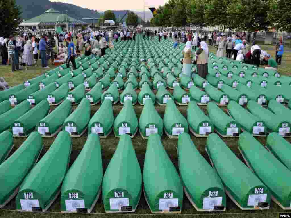 Coffins of newly identified victims during the preparations for the mass burial of another 775 victims.