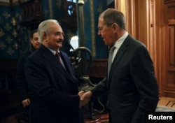 The commander of the Libyan National Army, Khalifa Haftar, shakes hands with Russian Foreign Minister Sergei Lavrov before talks in Moscow on January 13.