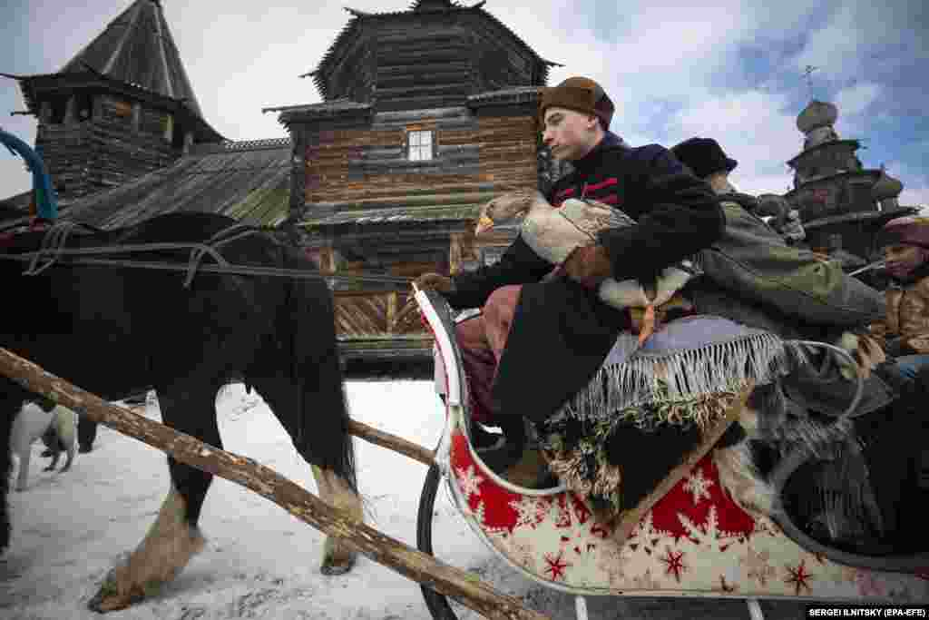 A man holds a goose before traditional goose fights at the Maslenitsa festival at the Museum of Wooden Architecture in the town of Suzdal on February 29, 2020.