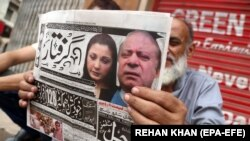 Pakistani newspapers carry front page news of the arrest of former Prime Minister Nawaz Sharif, in Karachi on July 14.