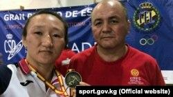 Айсулуу Тыныбекова с тренером Нурбеком Изабековым в Мадриде.