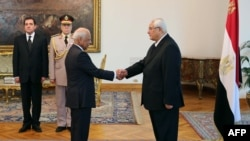 Interim President Adli Mansour (right) and interim Prime Minister Hazem el-Beblawi, at el-Beblawi's swearing-in on July 16.