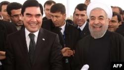 Turkmenistan's Gurbanguly Berdymukhammedov (left) and Iran's Hassan Rohani in happier times