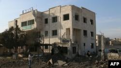Разрушенное здание в городе Аазаз