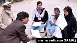 Khyber-Pakhtunkhwa Education Minister Sardar Babak (left) meeting with school girls