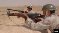Pakistani border guards observe the Afghan desert at the Pakistan-Afghanistan border