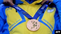The athletes covered their medals as a gesture in protest at the turmoil in their country.