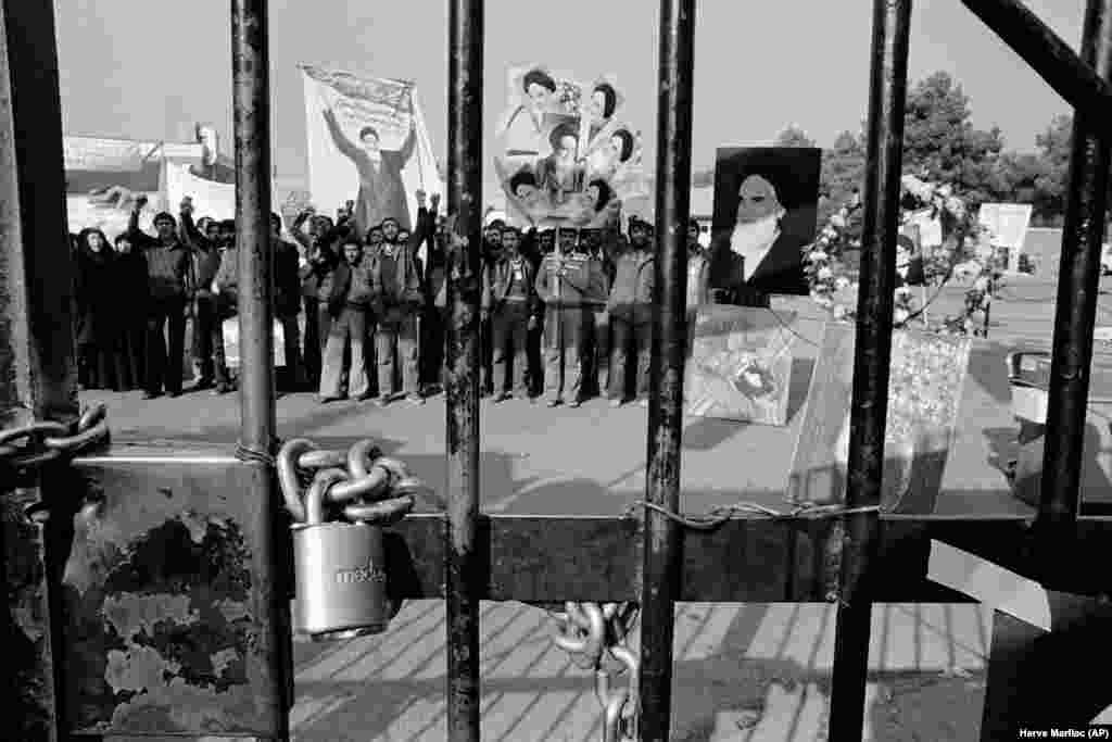 A padlock on the gate of the U.S. Embassy in Tehran on November 27, 1979, with students demonstrating inside after taking control of the compound. They took 52 Americans hostage and demanded the Shah be returned to Iran. The Iran hostage crisis would last 444 days until January 1981.