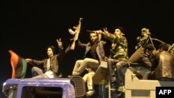 Rebel fighters in Benghazi celebrate the UN Security Council's resolution to impose a no-fly zone.