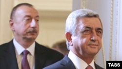 Russia -- Armenian President Serzh Sarkisian (R) and Azerbaijani President Ilham Aliyev meet to discuss the Nagorno-Karabakh settlement , in St. Petersburg, June 20, 2016