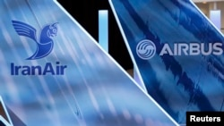 France -- The logos of Airbus group and IranAir are pictured the company IranAir takes delivery of the first new Western jet, an Airbus A231, under an international sanctions deal in Colomiers, near Toulouse, January 11, 2017