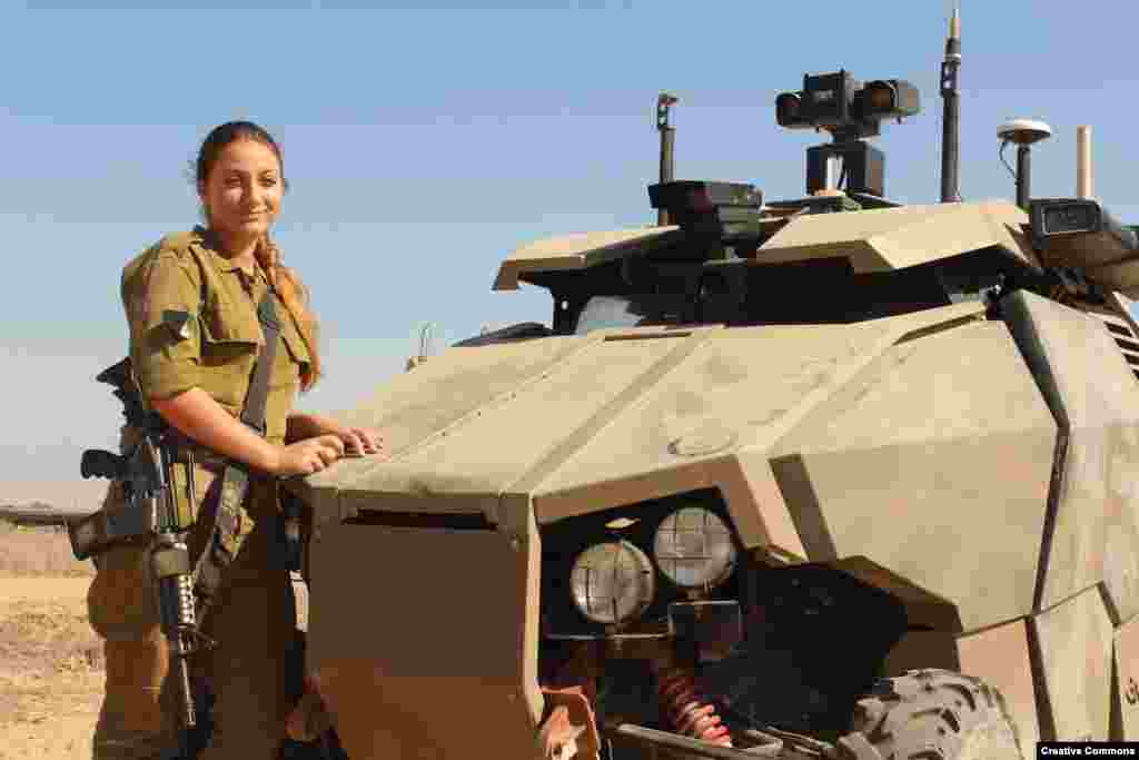 An Israeli soldier with the armor-plated Guardium. The vehicle can be fitted with an array of sensors and deliver hundreds of kilograms of cargo to troops under fire. Although the Guardium remains in service, the company behind the project wound down its development in 2016 citing a lack of international interest.