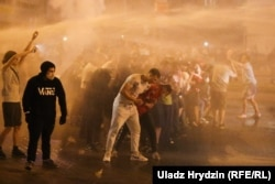 Protesters being blasted with water cannon in central Minsk on August 9.