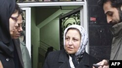 Shirin Ebadi leaves her office after authorities closed it down in December