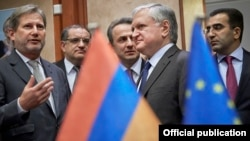 Belgium - EU Commissioner for European Neighborhood Policy Johannes Hahn (L) and Armenian Foreign Minister Edward Nalbandian speak at a meeting of the EU-Armenia Cooperation Council, Brussels, 18Jan2016.