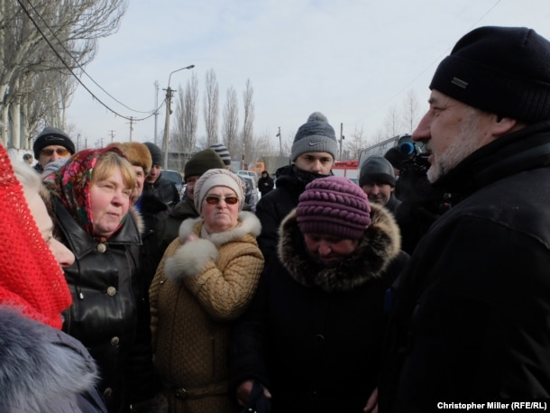 Donetsk Governor Pavlo Zhebrivskyy meets with townspeople at a humanitarian aid center in Avdiyivka.