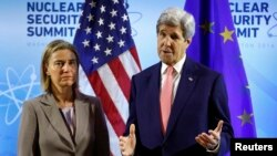 U.S.- U.S. Secretary of State John Kerry meets with European Union High Representative Federica Mogherini (L) at the Nuclear Summit in Washington April 1, 2016.