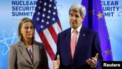 U.S.- U.S. Secretary of State John Kerry meets with European Union High Representative Federica Mogherini (L) at the Nuclear Summit in Washington April 1, 2016.