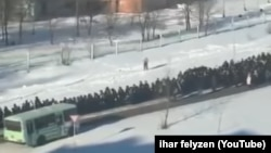 A screen grab from the YouTube footage showing the funeral procession