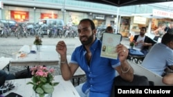 Ahmed Greri, who came to Germany from the Yarmouk Palestinian refugee camp in Syria, said he had been waiting for his identity documents for 17 months while authorities puzzled over his paperwork. He received a refugee travel document in late July.