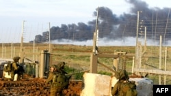 Israeli soldiers cross the border into the Gaza Strip.