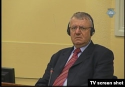 Vojislav Seselj during trial proceedings in The Hague in April 2012
