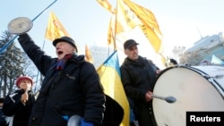 Demonstrators shout slogans while they take part in a rally of depositors in failed Ukrainian banks who demanded compensation of their deposits, in front of the parliament building in Kyiv on November 15.