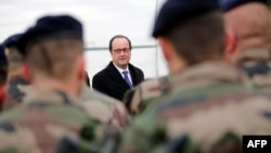 French President Francois Hollande reviews French soldiers at the Iraqi Counterterrorism Service Academy in Baghdad on January 2.