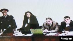(Poor quality image) The trial of opposition activist Nikol Pashinian (second from right) started in Yerevan on October 20.