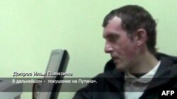 A Russian Channel One undated TV grab shows a man identified as Ilya Pyanzin, one of the suspected militants conspiring to kill Vladimir Putin, during an alleged confession to Ukrainian agents.