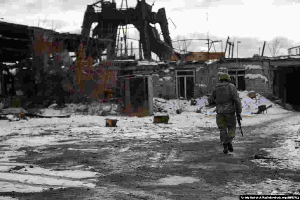 A Ukrainian soldier walks through destroyed mines in Butovka in Ukraine's Donetsk region on December 7. (Andriy Dubchak, RFE/RL)