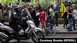 Still going strong? A police officer rides alongside an Occupy demonstration in New York in May.