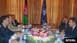 NATO chief Anders Fogh Rasmussen (right) during a visit with Afghan lawmakers in Kabul on August 7.