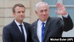 Presidenti francez, Emmanuel Macron (majtas) dhe kryeministri izraelit, Benjamin Netanyahu (djathtas), gjatë një takimi në korrik të këtij viti