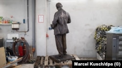 A Vladimir Lenin statue belonging to the Marxist-Leninist Party of Germany stands alone in storage.