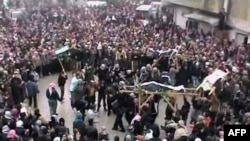 A video grab shows the funeral of people killed in Maaret al-Noman in the flashpoint northern Idlib province.