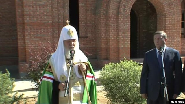 A screen grab of Russia's Orthodox Patriarch Kirill blessing the cornerstone of a new church outside the academy of the Federal Security Service on August 1.