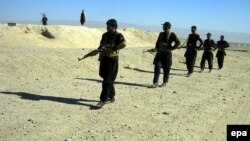 Pakistani security forces patrol along the Chaman border with Afghanistan.