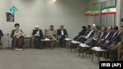 This image taken from video broadcast by Iran's IRIB televsion, in Tehran, Wednesday, June 17, 2009, shows Iran's Supreme Leader Ayatollah Ali Khamenei, 1st left, speaking at a meeting with representatives of presidential candidates.