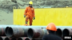 A gas refinery worker in Khorasan Razavi province, Semnan, Iran