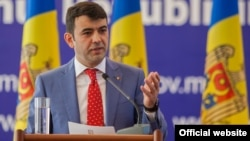 Moldovan Prime Minister Chiril Gaburici announces his resignation in Chisinau on June 12.