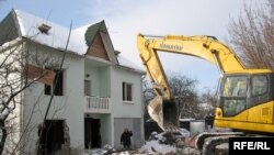 A home is demolished in the Moscow suburb of Rechnik.