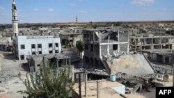 Після російського повітряного удару по місту Тель-Біса у провінції Хомс, 30 вересня 2015 року. Це місто контролює світська «Вільна сирійська армія», ісламістів у ньому немає