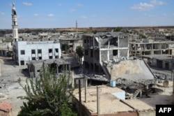 Сирия, разрушенный бомбежками центр Талбисы, северного пригорода Хомса